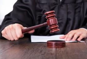 24123758 - close-up of a judge hitting mallet at desk
