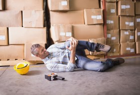 31882430 - side view of male worker lying on the floor in warehouse